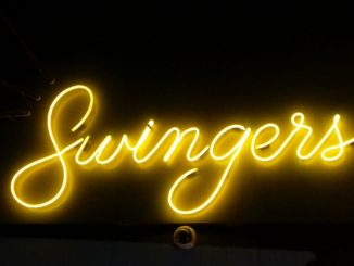 Neon Yellow Swingers Sign